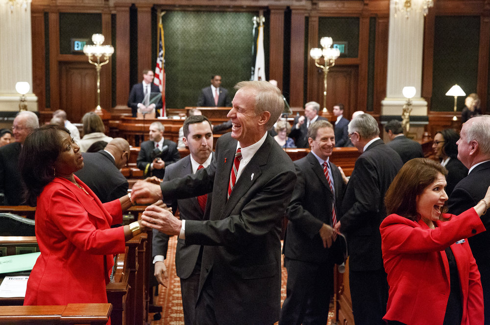 Rep. Mary Flowers, D-Chicago, speaks with Gov. Bruce Rauner after he delivered his Budget Address to a joint session of the General Assembly at the Capitol Wednesday, Feb. 15, 2017. Lt. Gov. Evelyn Sanguinetti is at right. [Rich Saal/The State Journal-Register]