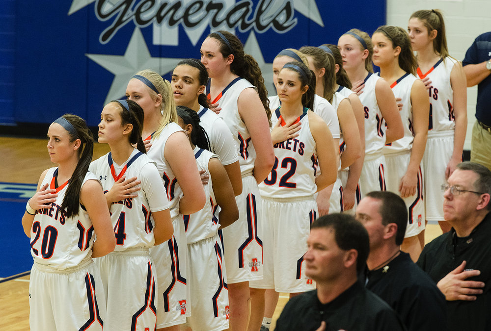 The Rochester Rockets stand for the national anthem before facing Mattoon during the Class 3A Decatur MacArthur Sectional title game at Decatur MacArthur High School February 23, 2017. [Ted Schurter/The State Journal-Register]