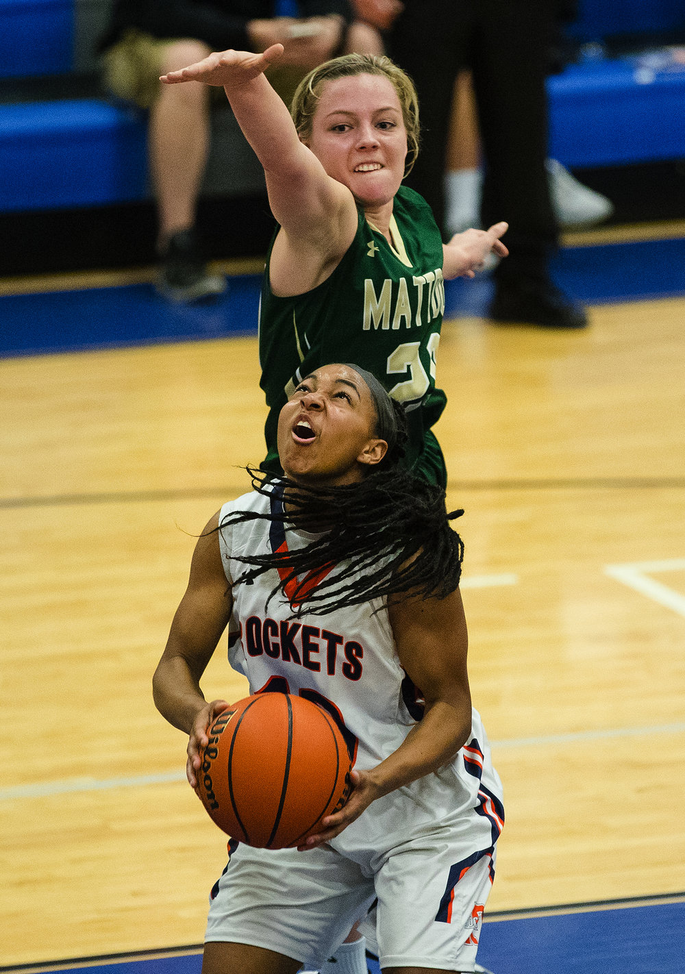 Rochester's Havilyn Dulin grabs a rebound and goes up for a shot in front of Mattoon's Paisley Meyer during the Class 3A Decatur MacArthur Sectional title game at Decatur MacArthur High School February 23, 2017. [Ted Schurter/The State Journal-Register]