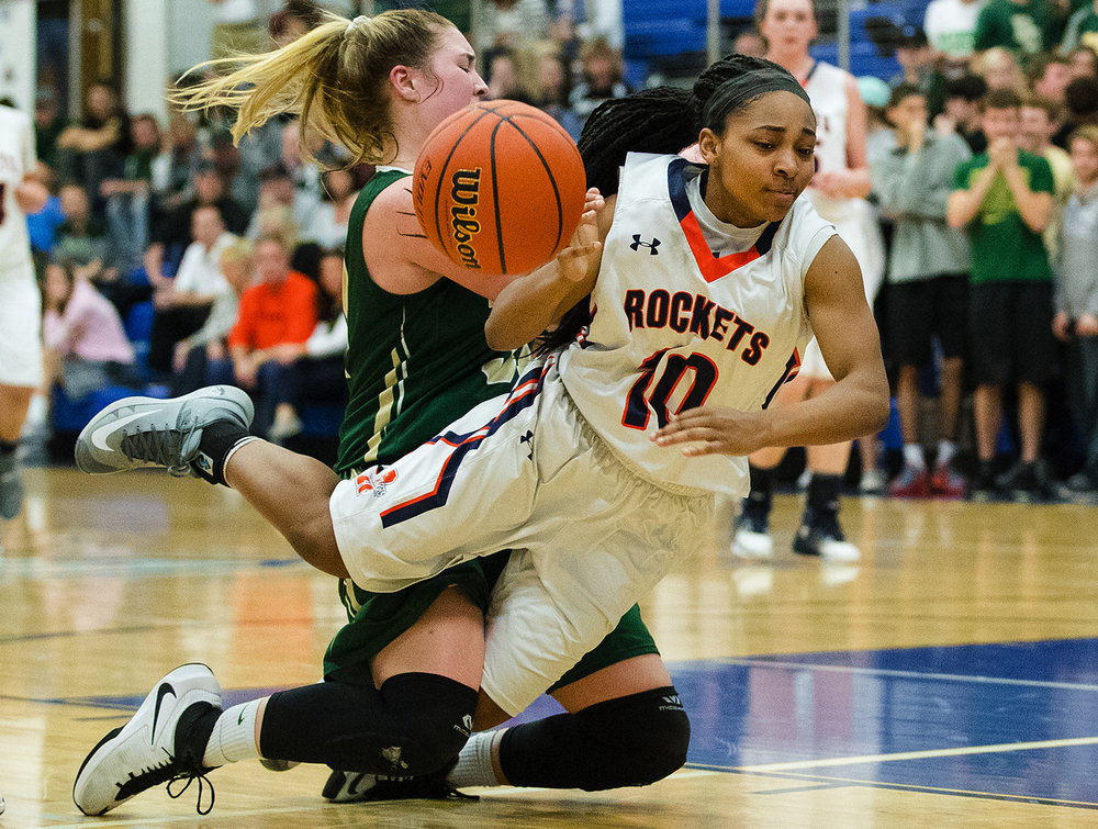 Rochester's Havilyn Dulin is tripped up on her way to the hoop against  Mattoon during the Class 3A Decatur MacArthur Sectional title game at Decatur MacArthur High School February 23, 2017. [Ted Schurter/The State Journal-Register]