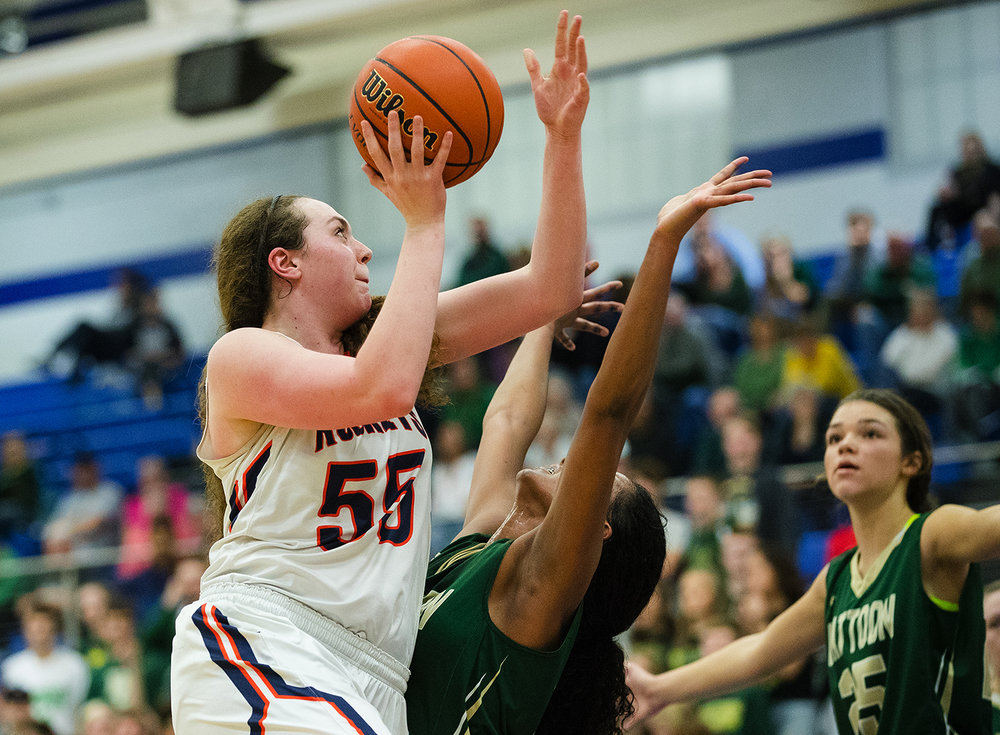 Rochester's Angela Perry shoots around Mattoon's Sierra Thompson during the Class 3A Decatur MacArthur Sectional title game at Decatur MacArthur High School February 23, 2017. [Ted Schurter/The State Journal-Register]