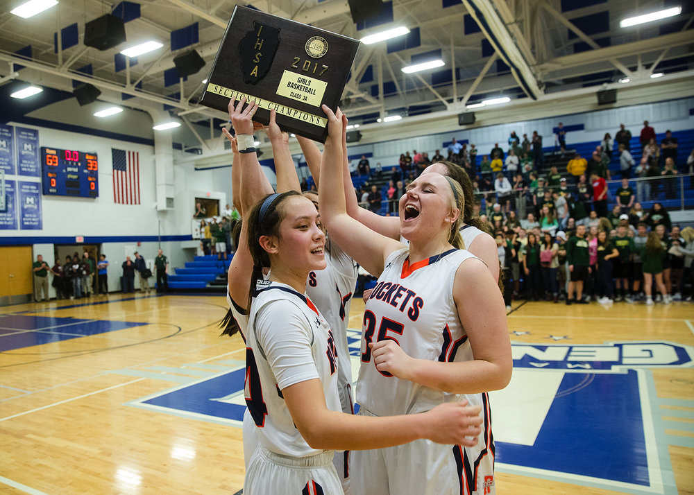Rochester's Nicole Robinson and Madison Faulkner celebrate with their plaque after defeating Mattoon's 69-39 during the Class 3A Decatur MacArthur Sectional title game at Decatur MacArthur High School February 23, 2017. [Ted Schurter/The State Journal-Register]
