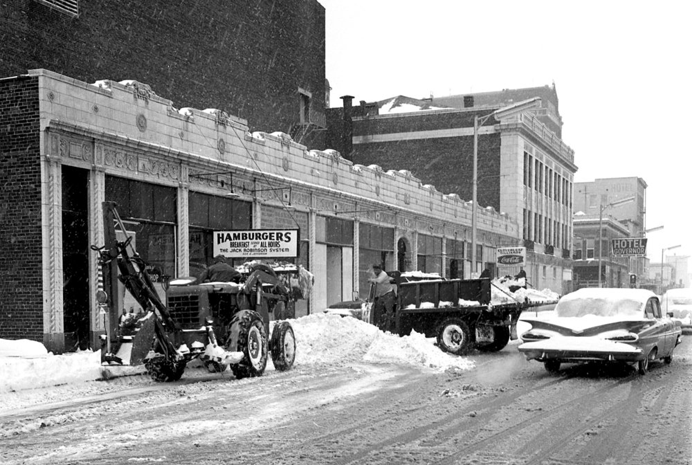 A city streets crew clears snow from the 500 block of E. Jefferson Street Feb. 24, 1965, on the north side of the Orpheum Theater building. File/The State Journal-Register