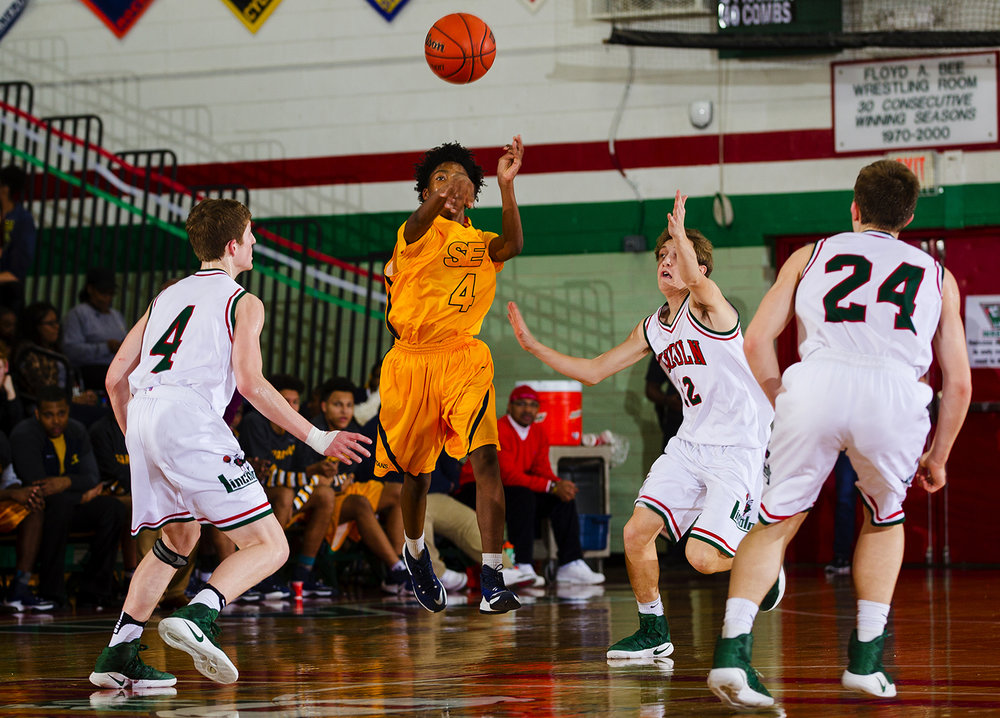 Southeast's Terrion Murdix fires a pass upcourt against Lincoln at Lincoln High School February 24, 2017. [Ted Schurter/The State Journal-Register]