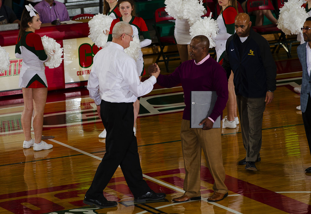 Lincoln head coach Neil Alexander greets Southeast head coach Lawrence Thomas before the start of Lincoln's final Central State Eight home game at Lincoln High School February 24, 2017. Thomas presented Alexander with a plaque to commemorate the occasion. [Ted Schurter/The State Journal-Register]