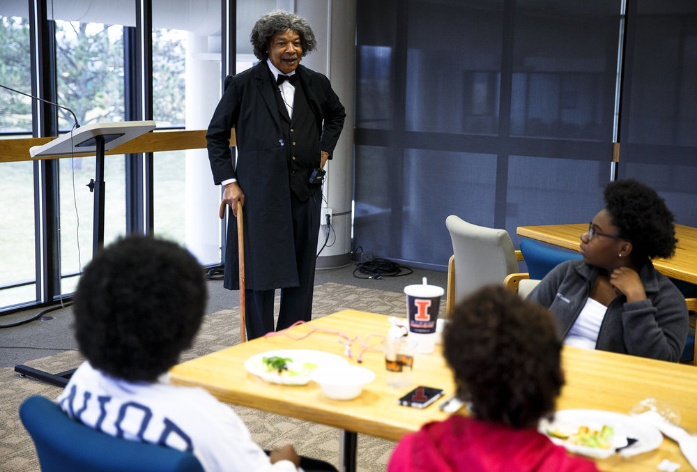 Robert Davis, an historic interpreter and reenactor. answers questions as Frederick Douglass from students after delivering a presentation of Douglass's oration in memory of President Abraham Lincoln in the Robert H. Stephens Room in Menard Hall on the campus of Lincoln Land Community College, Tuesday, Feb. 21, 2017, in Springfield, Ill. The event was part of a series at LLCC celebrating Black History Month and continues on Wednesday, Feb. 22 with the African-American Food and Vendor Day from 10 a.m. to 2 p.m in the A. Lincoln Commons and on Saturday, Feb. 25, the Black History Month Ebony Dance, 9 p.m. to midnight at the Trutter Center. [Justin L. Fowler/The State Journal-Register]