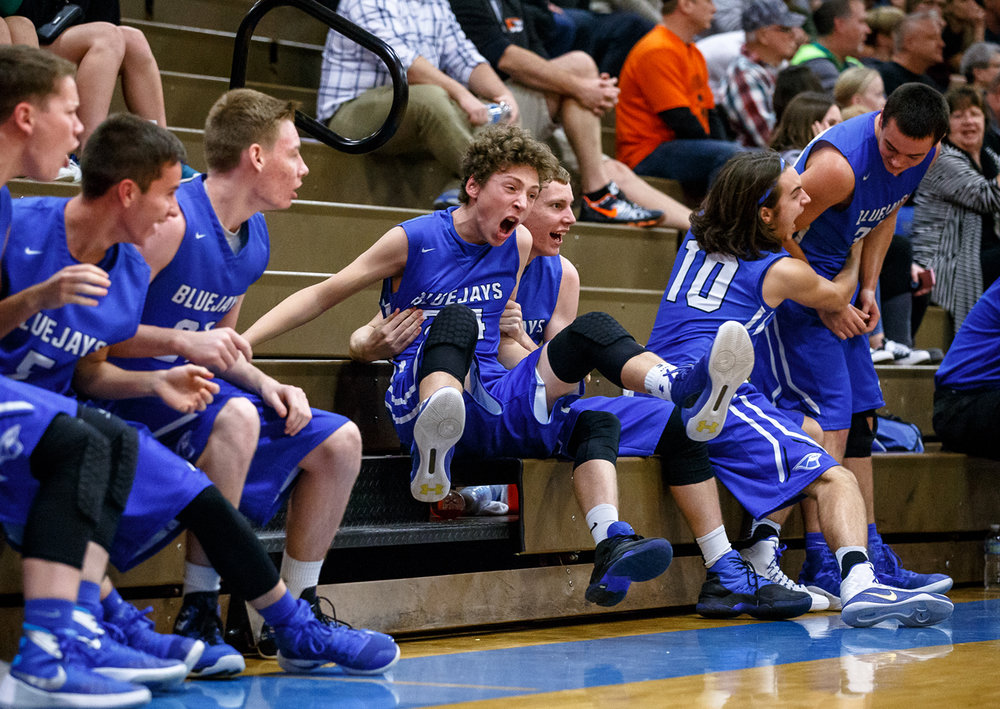 PORTA's Ben Baker (24) reacts along the sidelines with his teammates after PORTA's Max Muller (23) made a dunk against Illini Bluffs in the fourth quarter during the IHSA Class 2A PORTA Regional at PORTA High School, Wednesday, Feb. 22, 2017, in Petersburg, Ill. [Justin L. Fowler/The State Journal-Register]