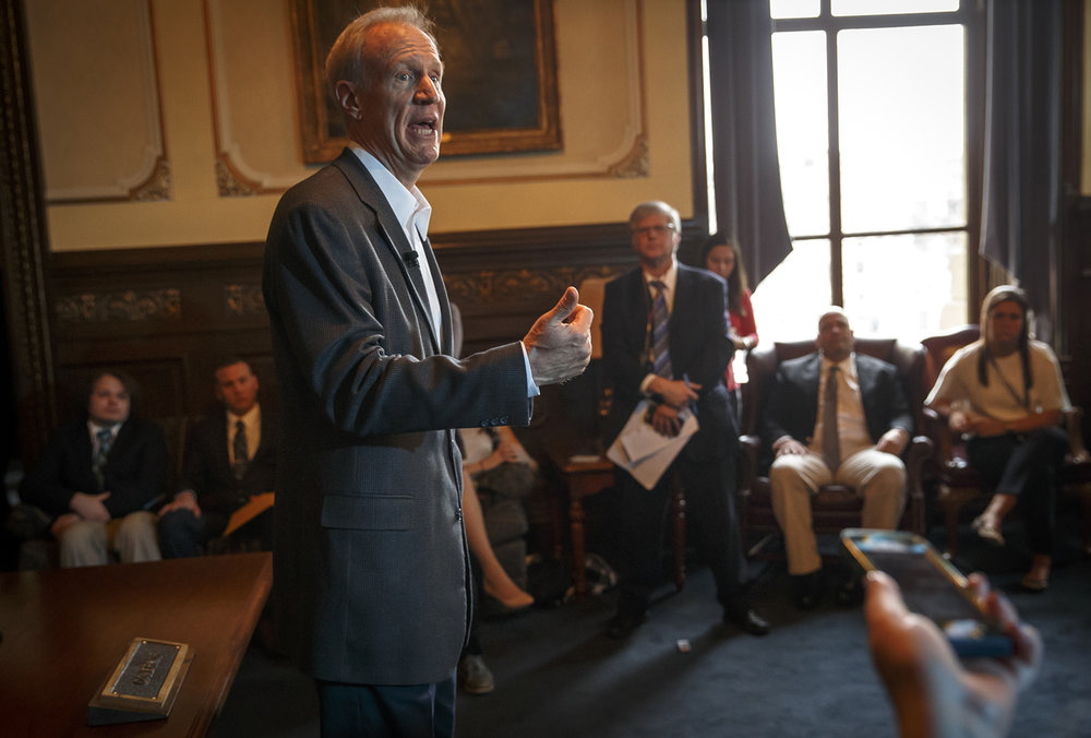 Illinois Governor Bruce Rauner answers questions about the members of AFSCME voting to authorize a first-time strike against the state during a press conference in the Governor's Office at the Illinois State Capitol, Thursday, Feb. 23, 2017, in Springfield, Ill. [Justin L. Fowler/The State Journal-Register]