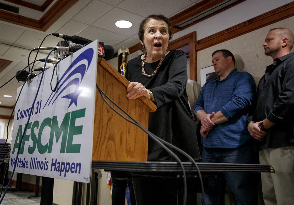 Roberta Lynch, the executive director of AFSCME Council 31, announces that AFSCME members have voted to authorize a first-time strike against the state during a press conference at the Illinois AFL-CIO building, Thursday, Feb. 23, 2017, in Springfield, Ill. [Justin L. Fowler/The State Journal-Register]