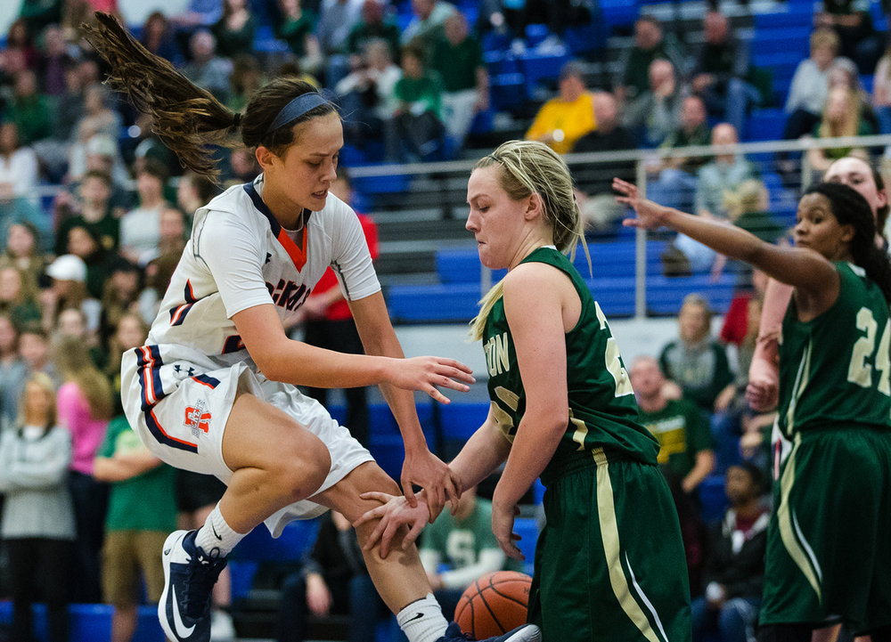 Rochester's Nicole Robinson crashes into Mattoon's Gillian Card during the Class 3A Decatur MacArthur Sectional title game at Decatur MacArthur High School February 23, 2017. [Ted Schurter/The State Journal-Register]