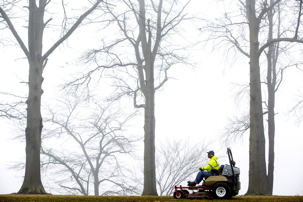 Marcus Barker, a City Water, Light & Power Lake Services employee, doesn't remember ever having the mower out in February. But the mild weather this week offered the opportunity to get ahead of mulching leaves, something that ordinarily is done later in the spring. Barker was working in Center Park Wednesday, Feb. 22, 2017. [Rich Saal/The State Journal-Register]