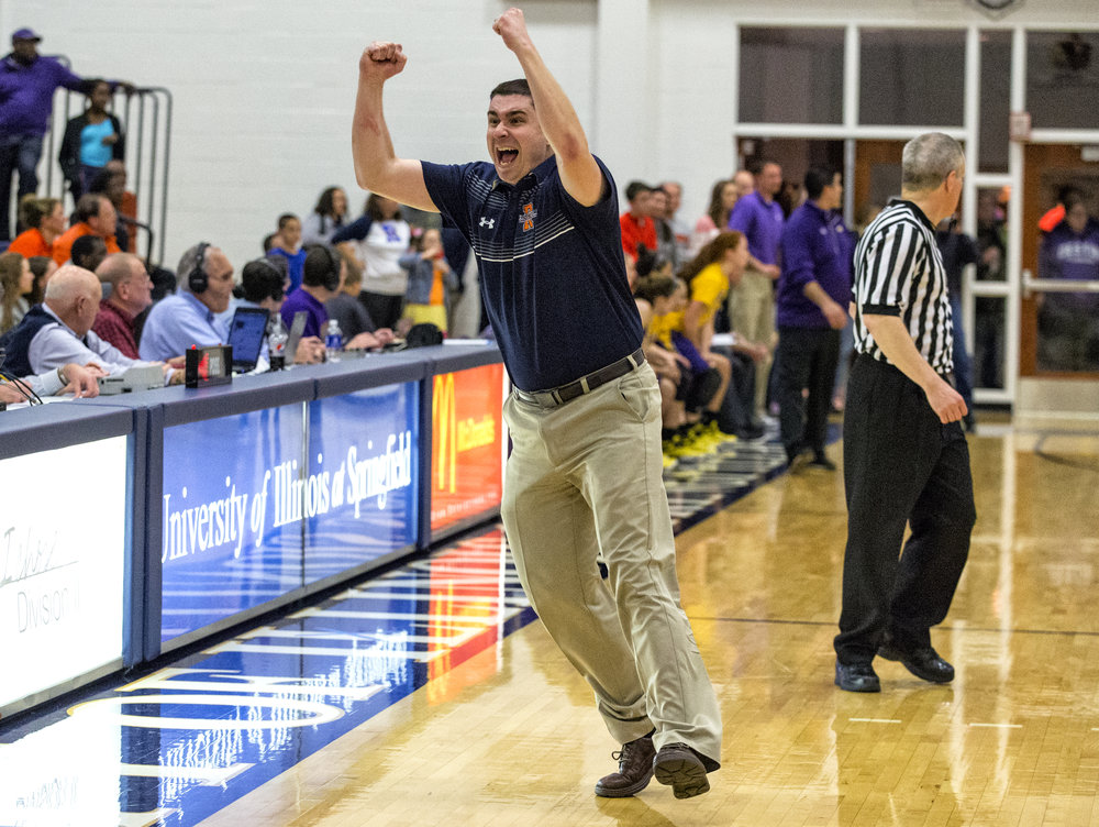 Rochester girls basketball head coach J.R. Boudouris celebrates after the buzzer sounds as the Rockets defeat Bethalto Civic Memorial 44-39 during the Class 3A Springfield Supersectional at The Recreation and Athletic Center on the University of Illinois Springfield campus, Monday, Feb. 27, 2017, in Springfield, Ill. [Justin L. Fowler/The State Journal-Register