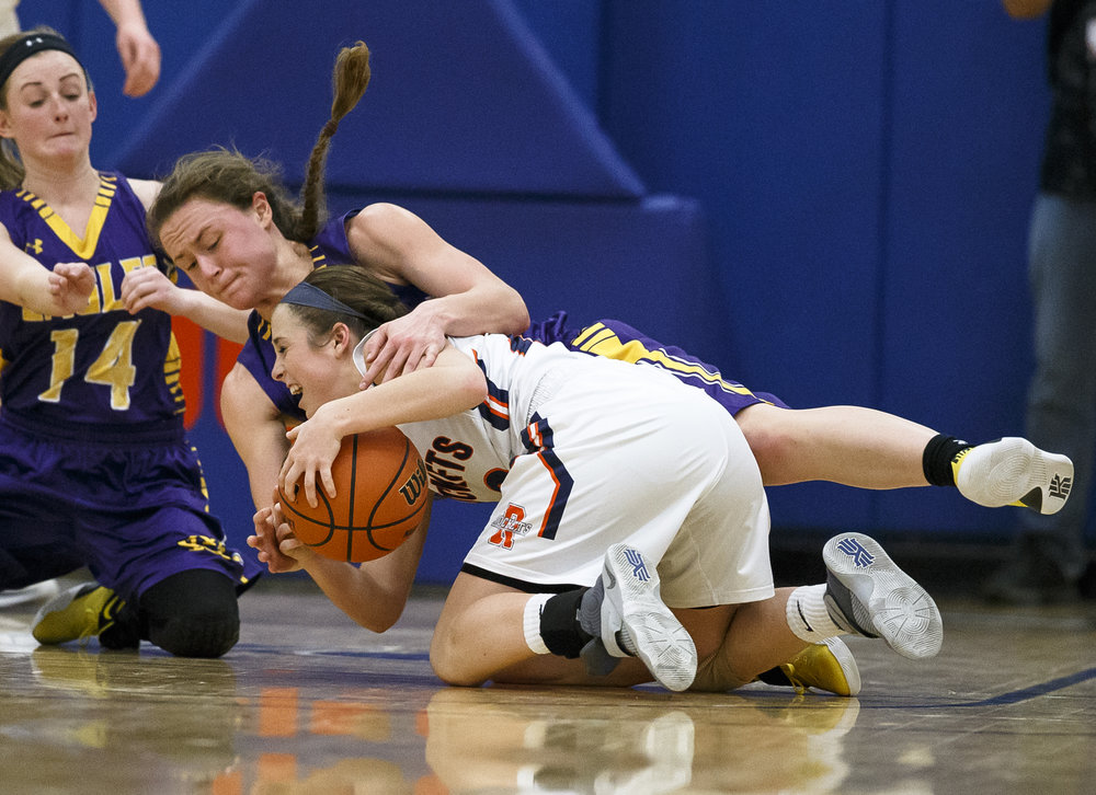 Bethalto Civic Memorial's Allie Troeckler (23) is called for a foul as she collides with Rochester's Aubrey Magro (20) as they hit floor going for possession of a loose ball in the third quarter during the Class 3A Springfield Supersectional at The Recreation and Athletic Center on the University of Illinois Springfield campus, Monday, Feb. 27, 2017, in Springfield, Ill. [Justin L. Fowler/The State Journal-Register