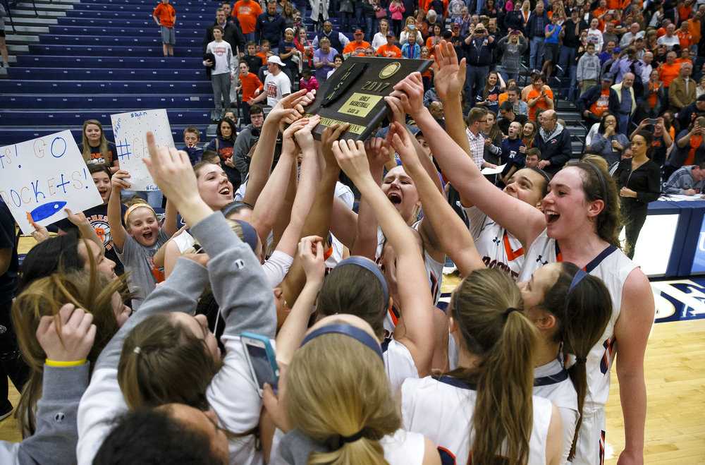 Rochester's Angela Perry (55), right, and the Rockets celebrate with the title after defeating Bethalto Civic Memorial 44-39 in the Class 3A Springfield Supersectional at The Recreation and Athletic Center on the University of Illinois Springfield campus, Monday, Feb. 27, 2017, in Springfield, Ill. [Justin L. Fowler/The State Journal-Register