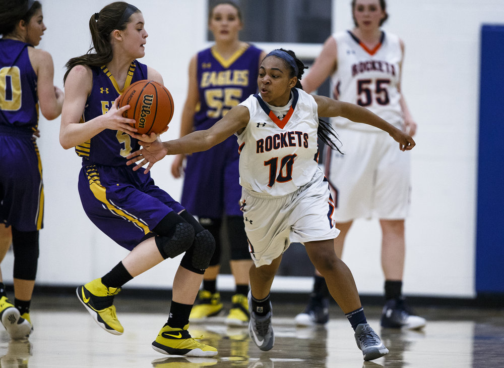 Rochester's Havilyn Dulin (10) forces a turnover from Bethalto Civic Memorial's Hannah Schmidt (5) in the fourth quarter during the Class 3A Springfield Supersectional at The Recreation and Athletic Center on the University of Illinois Springfield campus, Monday, Feb. 27, 2017, in Springfield, Ill. [Justin L. Fowler/The State Journal-Register