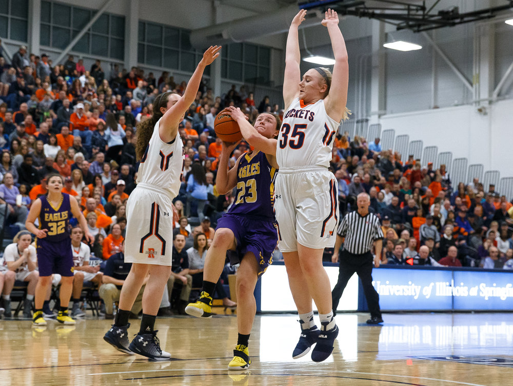 Bethalto Civic Memorial's Allie Troeckler (23) drives up to the basket against Rochester's Angela Perry (55) and Madison Faulkner (35) in the first quarter during the Class 3A Springfield Supersectional at The Recreation and Athletic Center on the University of Illinois Springfield campus, Monday, Feb. 27, 2017, in Springfield, Ill. [Justin L. Fowler/The State Journal-Register