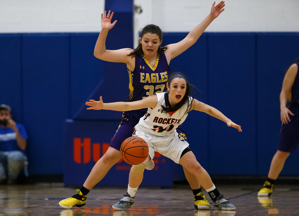 Rochester's Aubrey Magro (20) loses her dribble against Bethalto Civic Memorial's Alaira Tyus (32) in the first quarter during the Class 3A Springfield Supersectional at The Recreation and Athletic Center on the University of Illinois Springfield campus, Monday, Feb. 27, 2017, in Springfield, Ill. [Justin L. Fowler/The State Journal-Register