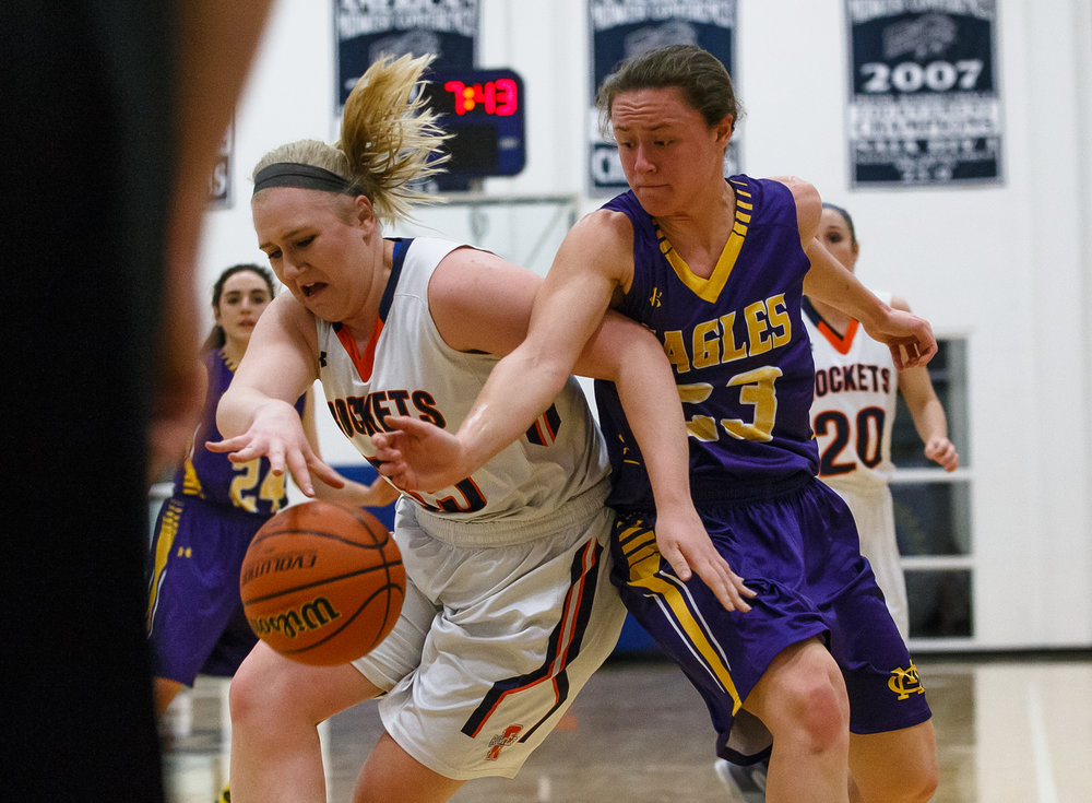 Rochester's Madison Faulkner (35) grabs a rebound in front of Bethalto Civic Memorial's Allie Troeckler (23) in the first quarter during the Class 3A Springfield Supersectional at The Recreation and Athletic Center on the University of Illinois Springfield campus, Monday, Feb. 27, 2017, in Springfield, Ill. [Justin L. Fowler/The State Journal-Register