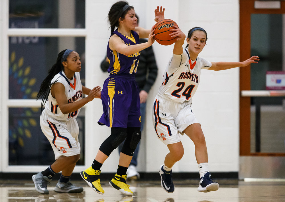 Rochester's Nicole Robinson (24) steals the ball away from Bethalto Civic Memorial's Kourtland Tyus (10) in the third quarter during the Class 3A Springfield Supersectional at The Recreation and Athletic Center on the University of Illinois Springfield campus, Monday, Feb. 27, 2017, in Springfield, Ill. [Justin L. Fowler/The State Journal-Register