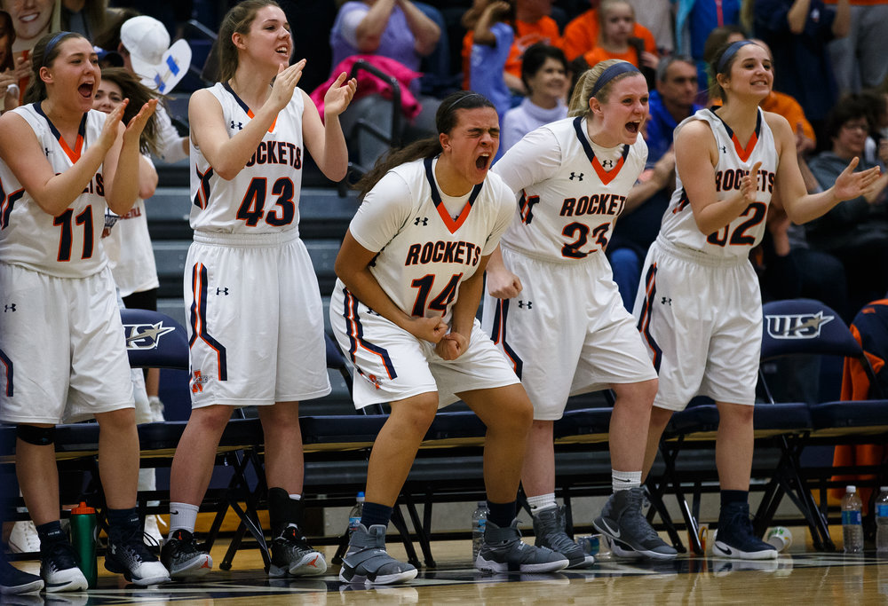 Rochester's Lyric Boone (14) and her teammates erupt from the bench as the Rockets take the lead against Bethalto Civic Memorial in the third quarter during the Class 3A Springfield Supersectional at The Recreation and Athletic Center on the University of Illinois Springfield campus, Monday, Feb. 27, 2017, in Springfield, Ill. [Justin L. Fowler/The State Journal-Register