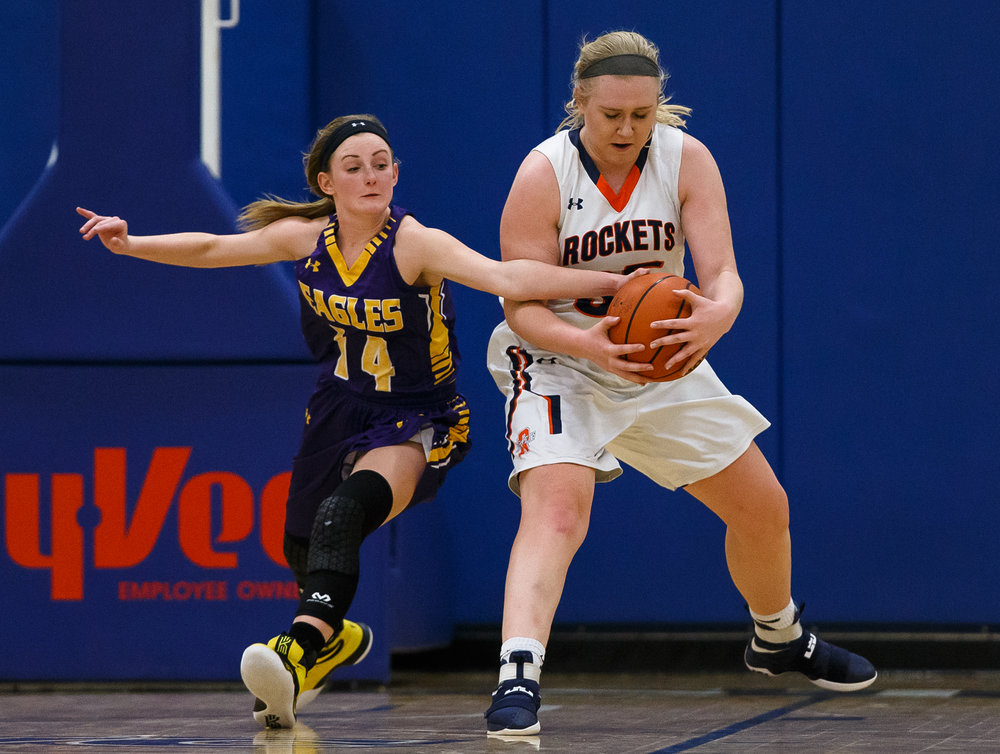 Rochester's Madison Faulkner (35) grabs a loose ball away from Bethalto Civic Memorial's Annika Ochs (14) in the third quarter during the Class 3A Springfield Supersectional at The Recreation and Athletic Center on the University of Illinois Springfield campus, Monday, Feb. 27, 2017, in Springfield, Ill. [Justin L. Fowler/The State Journal-Register