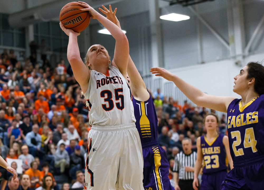 Rochester's Madison Faulkner (35) draws the foul as she goes up for a shot against Bethalto Civic Memorial's Hannah Schmidt (5) in the fourth quarter during the Class 3A Springfield Supersectional at The Recreation and Athletic Center on the University of Illinois Springfield campus, Monday, Feb. 27, 2017, in Springfield, Ill. [Justin L. Fowler/The State Journal-Register