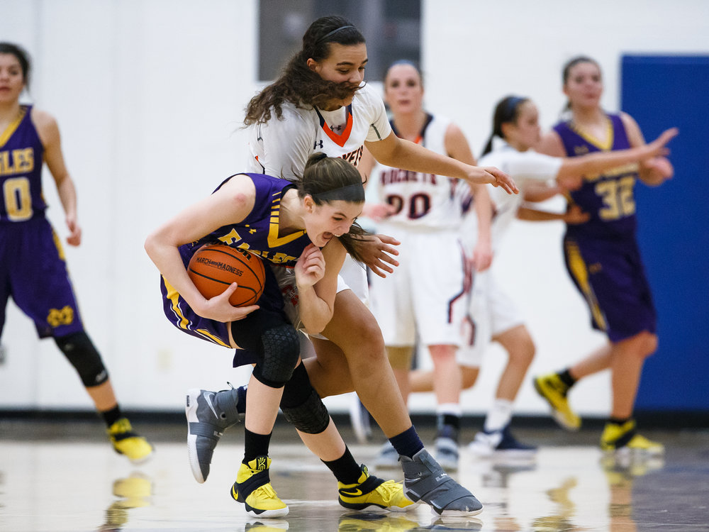 Rochester's Lyric Boone (14) collides with Bethalto Civic Memorial's Hannah Schmidt (5) and is called for a foul in the fourth quarter during the Class 3A Springfield Supersectional at The Recreation and Athletic Center on the University of Illinois Springfield campus, Monday, Feb. 27, 2017, in Springfield, Ill. [Justin L. Fowler/The State Journal-Register
