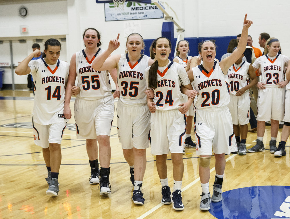 Rochester's Lyric Boone (14), Angela Perry (55), Madison Faulkner (35), Nicole Robinson (24) and Aubrey Magro (20) join together to accept the title after defeating Bethalto Civic Memorial 44-39 in the Class 3A Springfield Supersectional at The Recreation and Athletic Center on the University of Illinois Springfield campus, Monday, Feb. 27, 2017, in Springfield, Ill. [Justin L. Fowler/The State Journal-Register