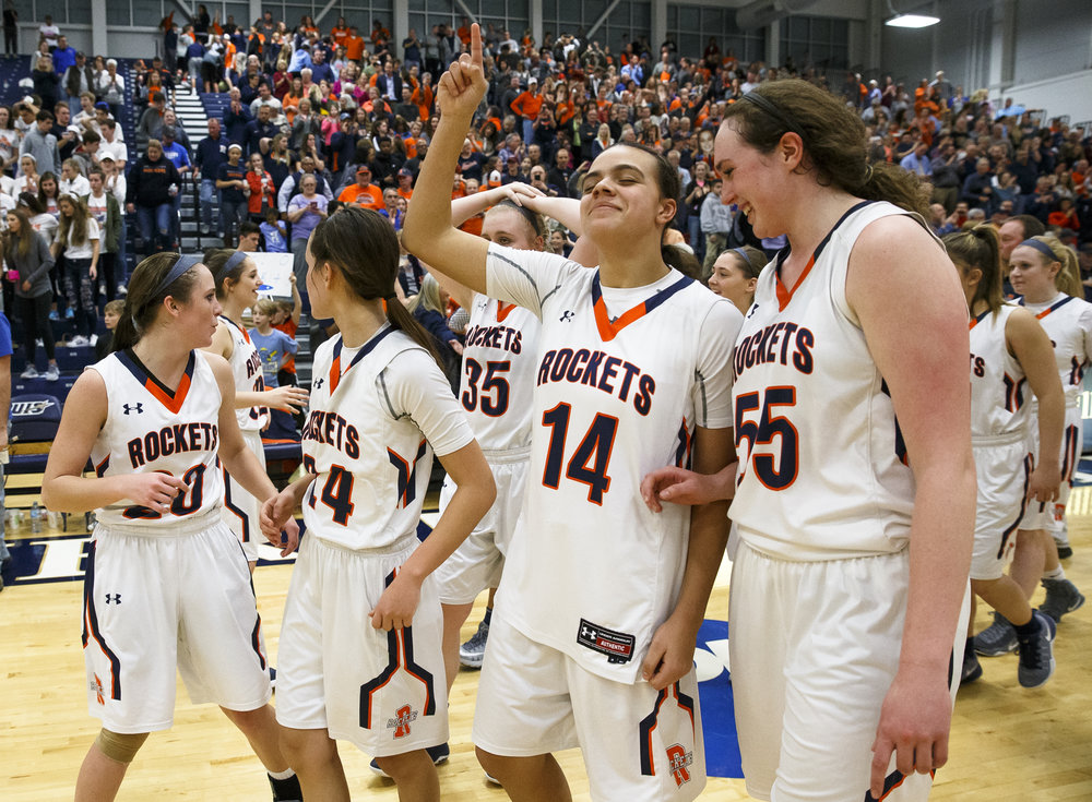 Rochester's Lyric Boone (14) and Rochester's Angela Perry (55) celebrate after the Rockets defeated Bethalto Civic Memorial 44-39 in the Class 3A Springfield Supersectional at The Recreation and Athletic Center on the University of Illinois Springfield campus, Monday, Feb. 27, 2017, in Springfield, Ill. [Justin L. Fowler/The State Journal-Register