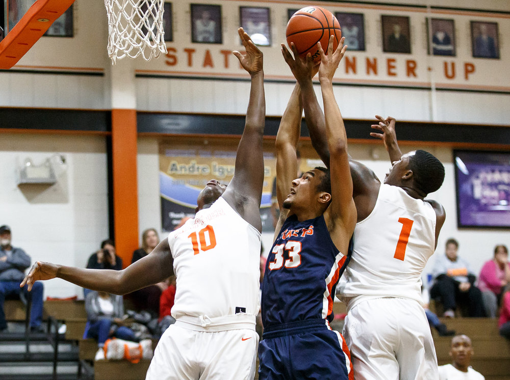 Rochester's Collin Stallworth (33) battles for a rebound against Lanphier's Corrington Jones (10) and Lanphier's Yaakema Rose (1) in the first quarter during the Class 3A Lanphier Regional at Lober-Nika Gymnasium, Tuesday, Feb. 28, 2017, in Springfield, Ill. [Justin L. Fowler/The State Journal-Register