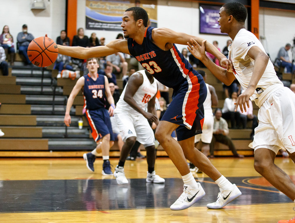 Rochester's Collin Stallworth (33) saves a ball from going out-of-bounds against Lanphier's Cardell McGee (2) in the first quarter during the Class 3A Lanphier Regional at Lober-Nika Gymnasium, Tuesday, Feb. 28, 2017, in Springfield, Ill. [Justin L. Fowler/The State Journal-Register