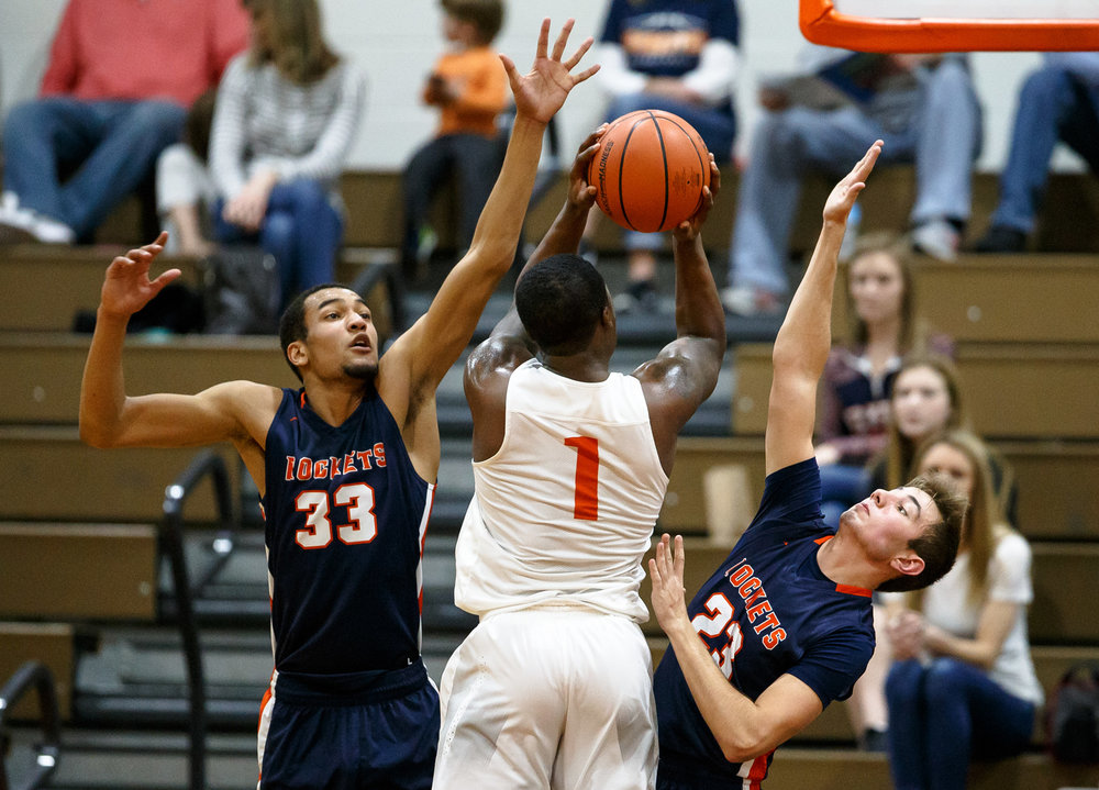 Lanphier's Yaakema Rose (1) goes to the basket against Rochester's Collin Stallworth (33) and Rochester's Adam Schwartz (23) in the second quarter during the Class 3A Lanphier Regional at Lober-Nika Gymnasium, Tuesday, Feb. 28, 2017, in Springfield, Ill. [Justin L. Fowler/The State Journal-Register
