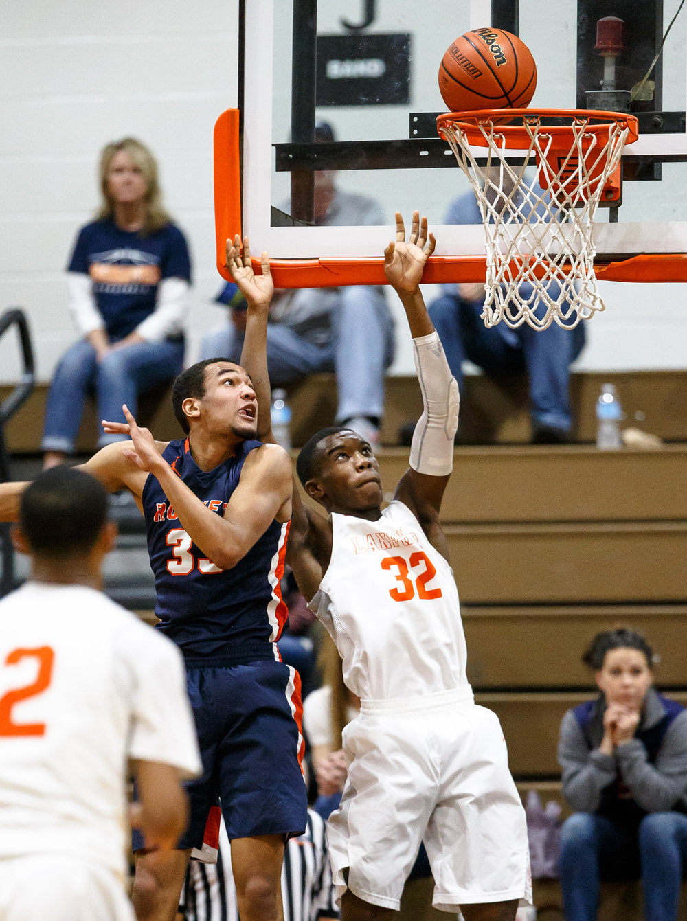 Lanphier's Karl Wright III (32) goes for the put-back against Rochester's Collin Stallworth (33) in the second quarter during the Class 3A Lanphier Regional at Lober-Nika Gymnasium, Tuesday, Feb. 28, 2017, in Springfield, Ill. [Justin L. Fowler/The State Journal-Register