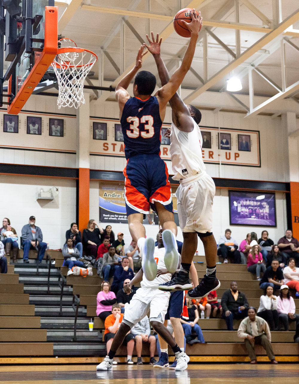 Lanphier's Yaakema Rose (1) fouls Rochester's Collin Stallworth (33) as he attempts a dunk in the first quarter during the Class 3A Lanphier Regional at Lober-Nika Gymnasium, Tuesday, Feb. 28, 2017, in Springfield, Ill. [Justin L. Fowler/The State Journal-Register