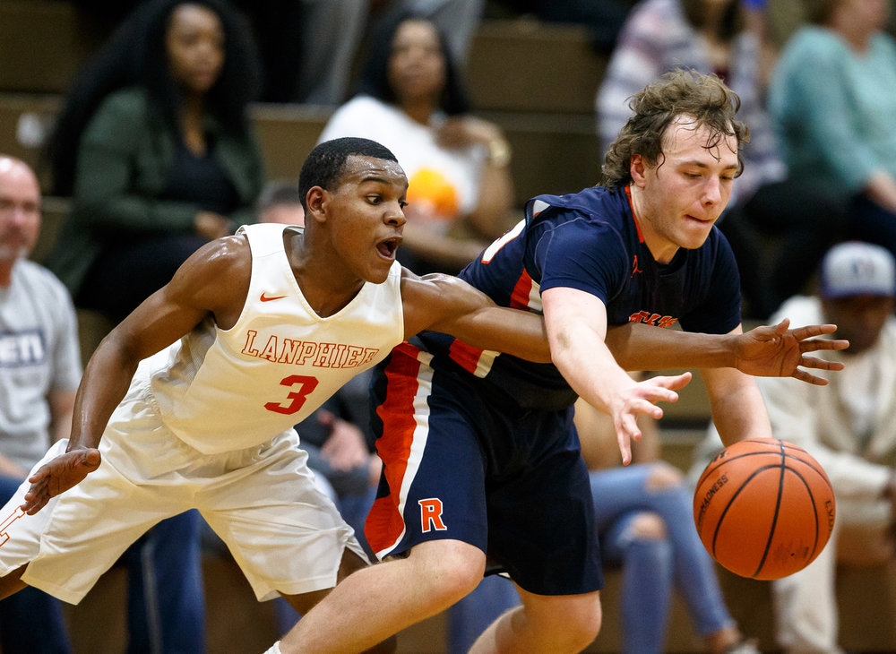 Lanphier's Aundrae Williams (3) tries to force a turnover against Rochester's Sam Baker (25) in the third quarter during the Class 3A Lanphier Regional at Lober-Nika Gymnasium, Tuesday, Feb. 28, 2017, in Springfield, Ill. [Justin L. Fowler/The State Journal-Register