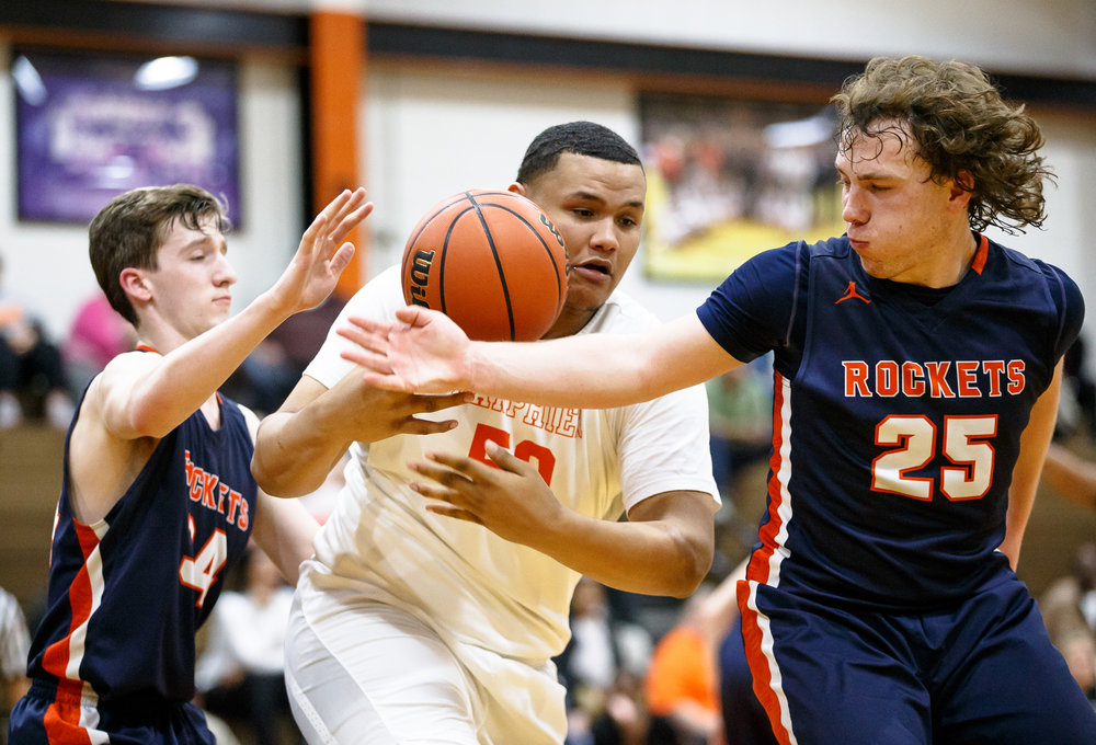 Rochester's Sam Baker (25) knocks the ball away from Lanphier's Will Boles (50) in the third quarter during the Class 3A Lanphier Regional at Lober-Nika Gymnasium, Tuesday, Feb. 28, 2017, in Springfield, Ill. [Justin L. Fowler/The State Journal-Register