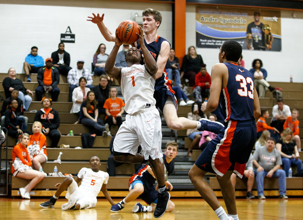 Lanphier's Yaakema Rose (1) gets fouled by Rochester's Tristan Sutker (34) as he goes up for a shot in the third quarter during the Class 3A Lanphier Regional at Lober-Nika Gymnasium, Tuesday, Feb. 28, 2017, in Springfield, Ill. [Justin L. Fowler/The State Journal-Register