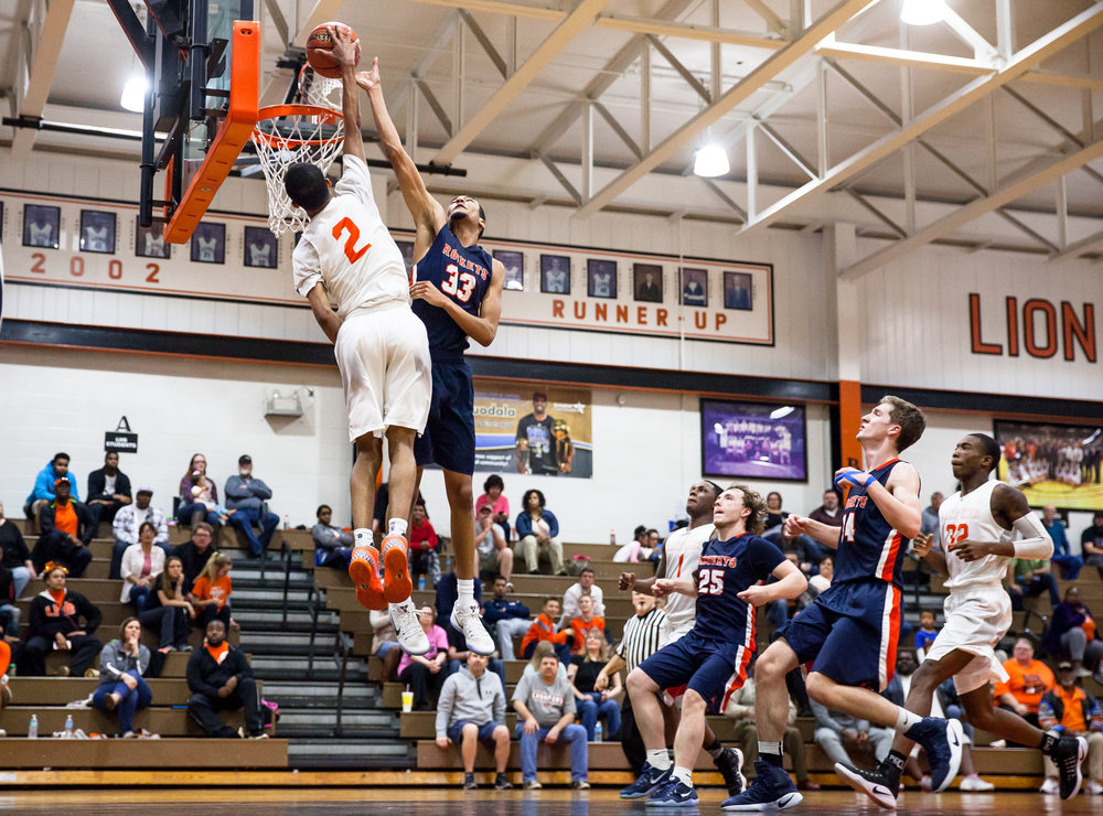 Lanphier's Cardell McGee (2) attempts a dunk against Rochester's Collin Stallworth (33) in the fourth quarter during the Class 3A Lanphier Regional at Lober-Nika Gymnasium, Tuesday, Feb. 28, 2017, in Springfield, Ill. [Justin L. Fowler/The State Journal-Register