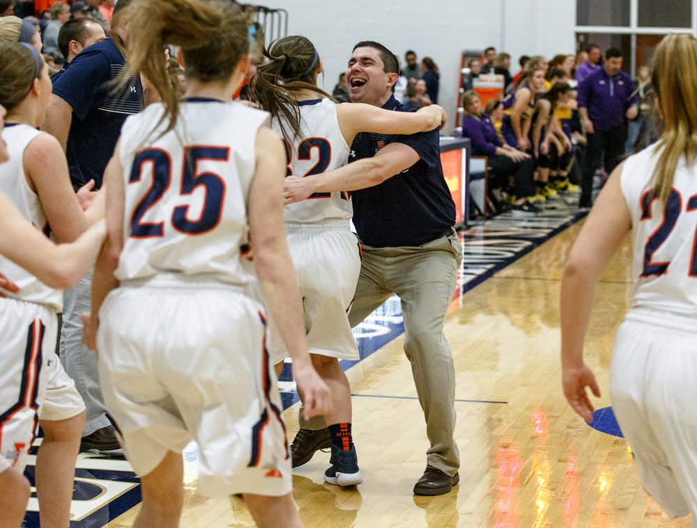 Rochester girls basketball head coach J.R. Boudouris hugs his daughter Rochester's Peyton Boudouris (32) after the Rockets defeated Bethalto Civic Memorial 44-39 during the Class 3A Springfield Supersectional at The Recreation and Athletic Center on the University of Illinois Springfield campus, Monday, Feb. 27, 2017, in Springfield, Ill. [Justin L. Fowler/The State Journal-Register