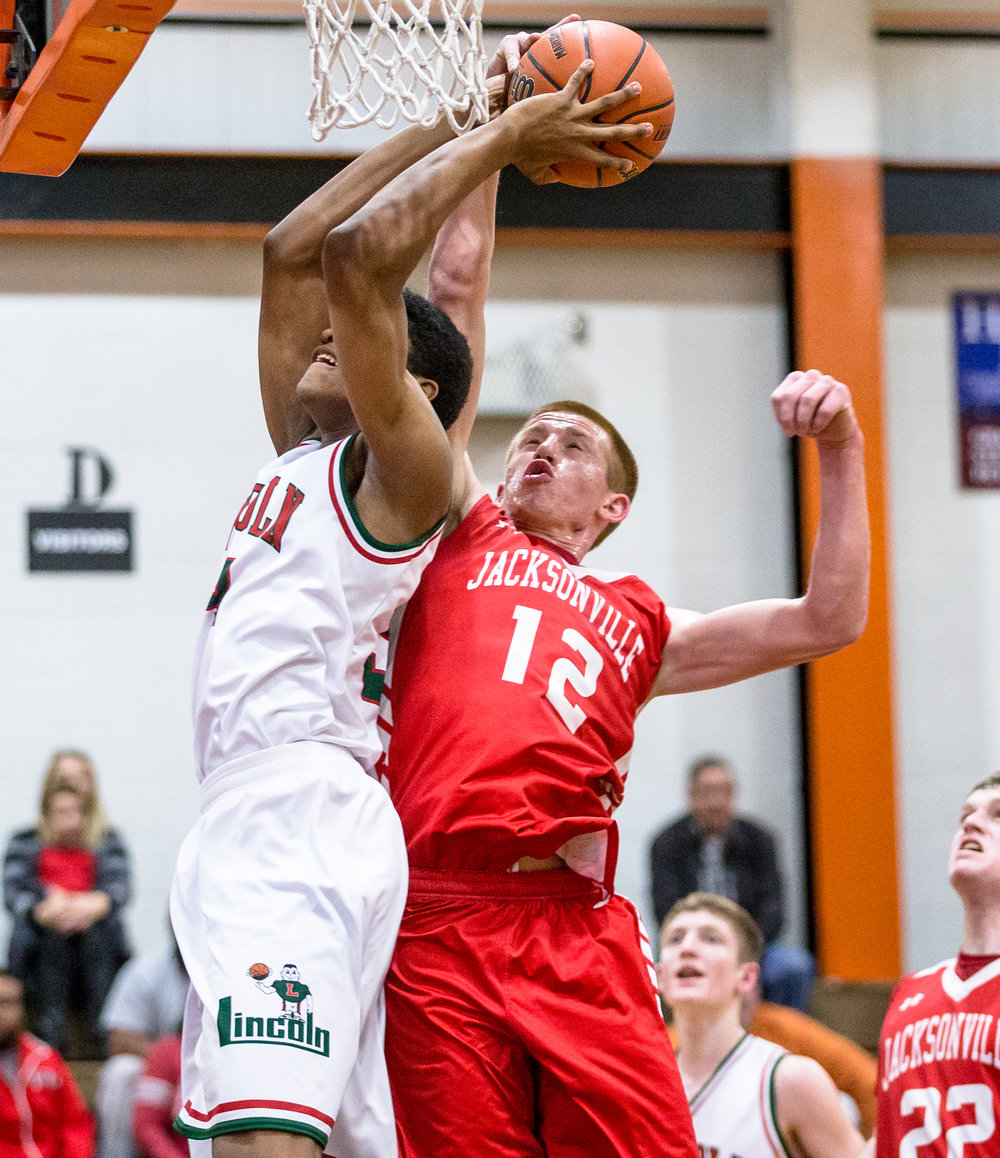 Jacksonville's Brandon McCombs (12) is called for a foul trying to block a shot from Lincoln's Jermaine Hamlin (34) in the second quarter during the Class 3A Lanphier Regional at Lober-Nika Gymnasium, Wednesday, March 1, 2017, in Springfield, Ill. [Justin L. Fowler/The State Journal-Register