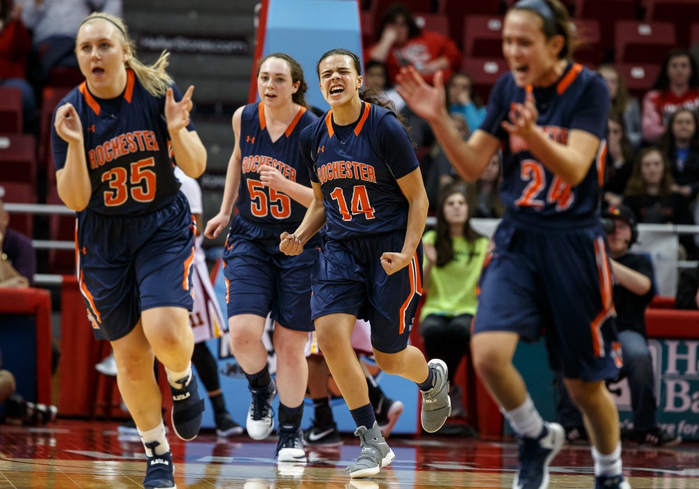 Rochester's Lyric Boone (14) and the Rockets celebrate after taking the lead going into the second quarter against Chicago Marshall in the IHSA Class 3A Girls State Basketball Tournament semifinals at Redbird Arena, Friday, March 3, 2017, in Normal, Ill. [Justin L. Fowler/The State Journal-Register