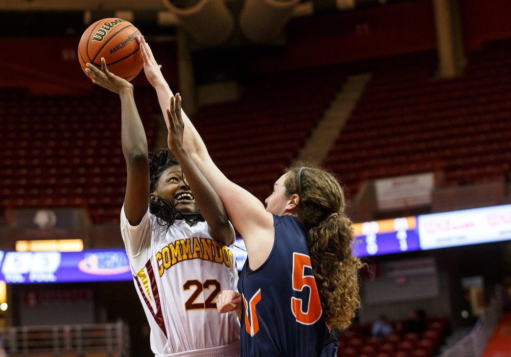 Rochester's Angela Perry (55) gets a hand on a shot from from Chicago Marshall's Julliunn Redmond (22) in the second quarter of the IHSA Class 3A Girls State Basketball Tournament semifinals at Redbird Arena, Friday, March 3, 2017, in Normal, Ill. [Justin L. Fowler/The State Journal-Register