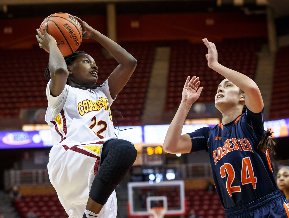 Chicago Marshall's Julliunn Redmond (22) goes up to the basket agaisnst Rochester's Nicole Robinson (24) in the second quarter of the IHSA Class 3A Girls State Basketball Tournament semifinals at Redbird Arena, Friday, March 3, 2017, in Normal, Ill. [Justin L. Fowler/The State Journal-Register