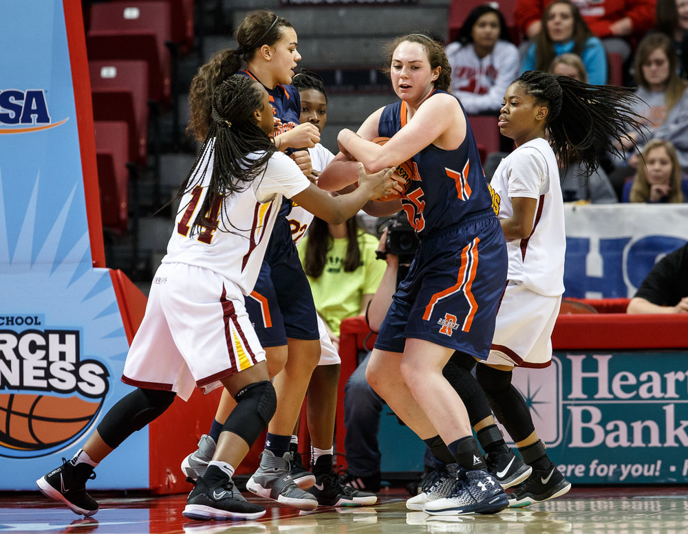 Rochester's Angela Perry (55) wraps up a rebound against Chicago Marshall in the third quarter of the IHSA Class 3A Girls State Basketball Tournament semifinals at Redbird Arena, Friday, March 3, 2017, in Normal, Ill. [Justin L. Fowler/The State Journal-Register