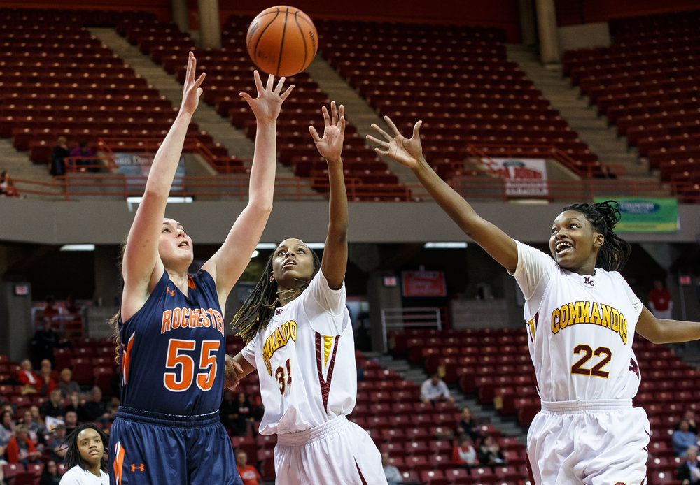 Rochester's Angela Perry (55) goes for a rebound agianst Chicago Marshall's Tekia Mack (31) in the third quarter of the IHSA Class 3A Girls State Basketball Tournament semifinals at Redbird Arena, Friday, March 3, 2017, in Normal, Ill. [Justin L. Fowler/The State Journal-Register