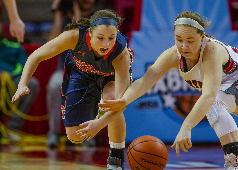Rochester's Aubrey Magro and Morton's Caylie Jones dive for a loose ball during the 2017 IHSA Girls Basketball Class 3A championship game at Redbird Arena Saturday, March 3, 2017. [Ted Schurter/The State Journal-Register]