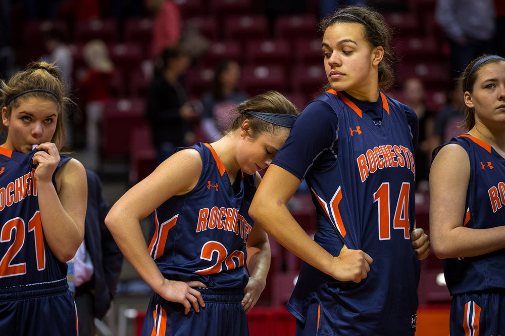 Rochester's Aubrey Magro leans her head on Lyric Boone's shoulder as they wait for the trophy presentation during the 2017 IHSA Girls Basketball Class 3A championship game at Redbird Arena Saturday, March 3, 2017. [Ted Schurter/The State Journal-Register]