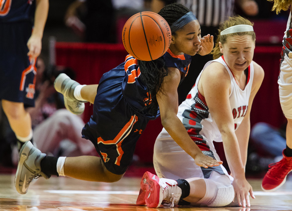 Rochester's Havilyn Dulin falls over Morton's Ivy Nichols during the 2017 IHSA Girls Basketball Class 3A championship game at Redbird Arena Saturday, March 3, 2017. [Ted Schurter/The State Journal-Register]