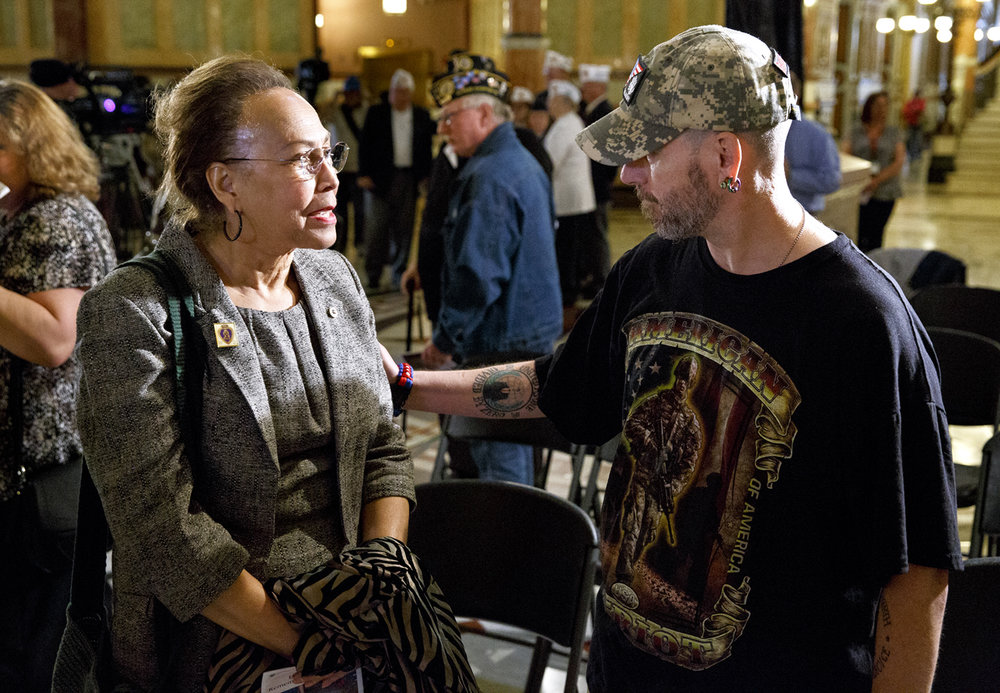 Daniel Jacoby greets Phillipa Porter of Springfield, the mother of Marine lance corporal Christian Porter, after the 26th Desert Storm Remembrance Ceremony Tuesday, Feb. 28, 2017 at the Capitol. Christian Porter was killed in action during the conflict Feb. 24, 1991 and Jacoby was a school classmate of Christian's who wanted to say hello. [Rich Saal/The State Journal-Register]