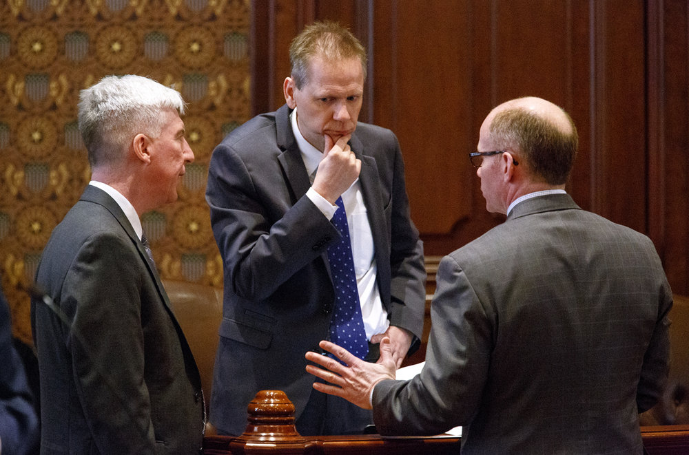 Sen. Michael Connelly, R-Naperville, left , Sen. Dale Righter, R-Mattoon and Sen. Don Harmon, D-Oak Park, discuss a piece of the so-called bipartisan grand bargain budget deal in the Illinois Senate Tuesday, Feb. 28, 2017 at the Capitol in Springfield, Ill. The Senate voted on pieces of the package but plan to take up big issue like tax hikes and workers comp Wednesday. [Rich Saal/The State Journal-Register]